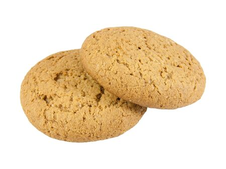 Two oatmeal cookies. Isolated on the white background.  Stock Photo