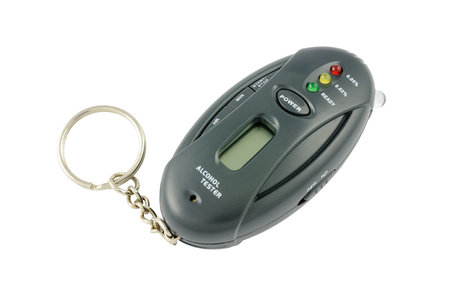 sobriety: Pocket alcohol tester on a keychain.  Stock Photo