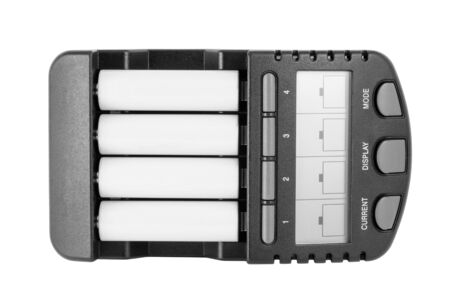 Intelligent Ni-MH battery charger with AA batteries. Isolated on white backgroungd with clipping path.