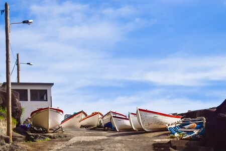 Old colourful wooden boats with peeling paint Imagens