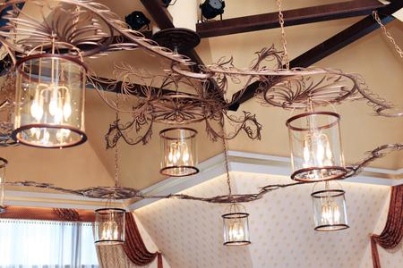 Vintage chandelier in dark pastel colors with lamps