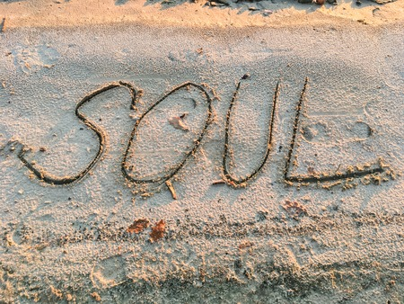 words written in the sand on the beach by a man 1