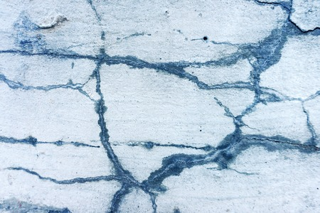 abstract concrete background closeup, grey light cracked