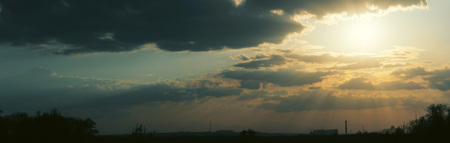 sunset panorama with magic clouds 写真素材