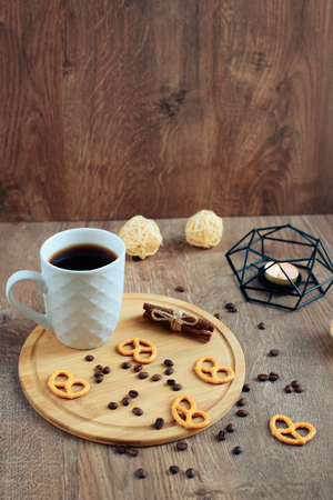 cup of coffee on a wooden background, set in warm brown tones