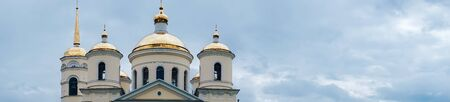 panorama of the church in the blue sky with white clouds