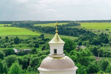 panorama of the church on a background of green countryside in summer Stock fotó