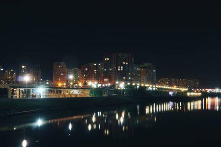 landscape of the night city by the river Stok Fotoğraf