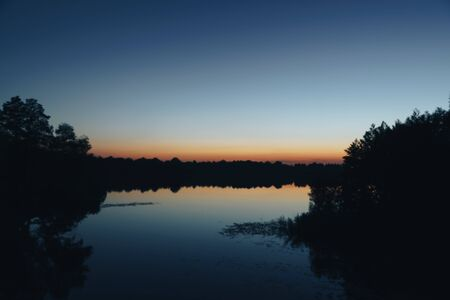 slightly blurred landscape of a night lake