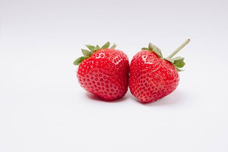 red tasty strawberries on a white background
