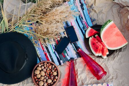 river picnic with lemonade and nuts and watermelon