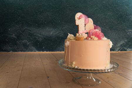beautiful delicious decorated cake with the number one Фото со стока - 133783120
