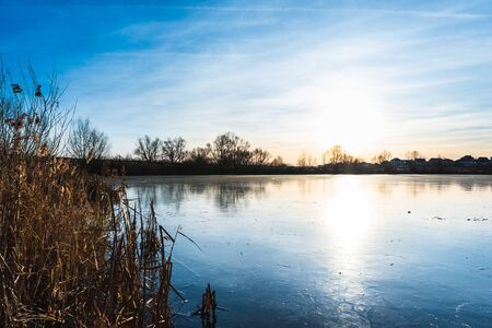 beautiful winter landscape of ice-covered river Фото со стока - 135576544
