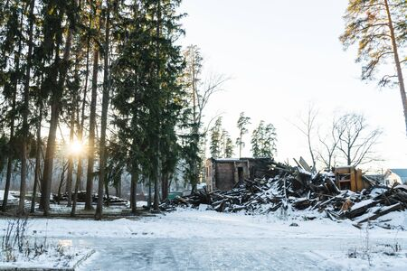 an old abandoned house in a pine winter forest Фото со стока - 136860919