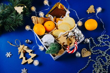 Christmas set with tangerines and cookies on a blue background