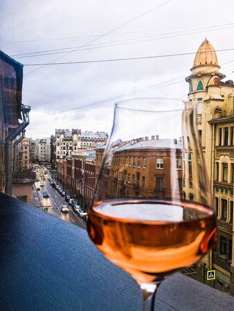 a glass of wine on the background of St. Petersburg streets Фото со стока - 136862413
