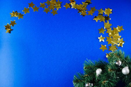 gold confetti stars on blue background Фото со стока