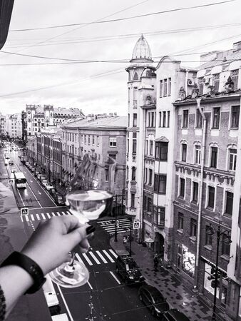 a glass of wine on the background of St. Petersburg streets Фото со стока - 136863543