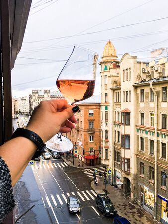 a glass of wine on the background of St. Petersburg streets Фото со стока - 136863548