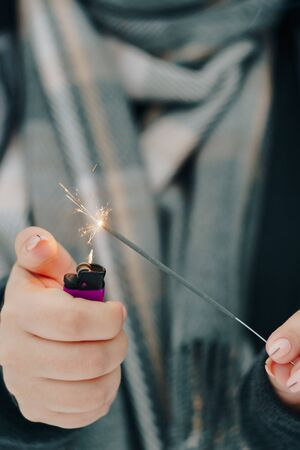 girl with sparkler in hands
