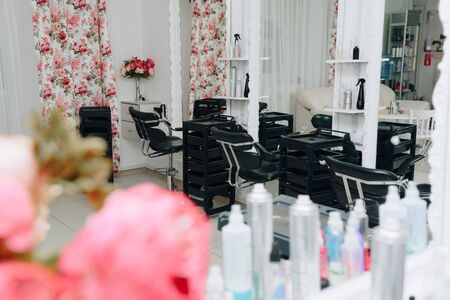 large pink peonies inside a beauty salon