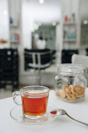 Cup of tea with cookies in a jar Фото со стока