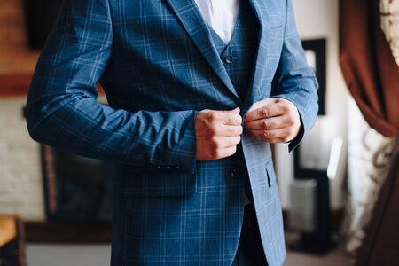 details of the grooms jacket at the wedding Фото со стока