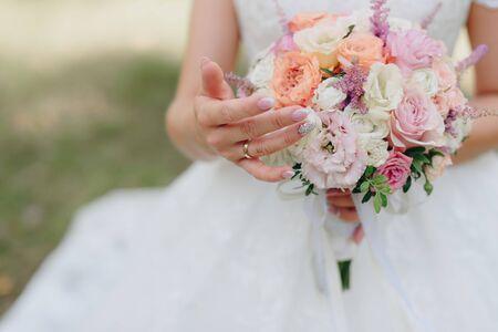 wedding bouquet at brides hands