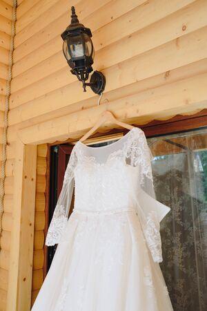 preparing the bride for the wedding in a wedding dress Фото со стока