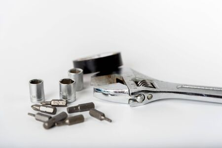 adjustable spanner and other tools on a white background