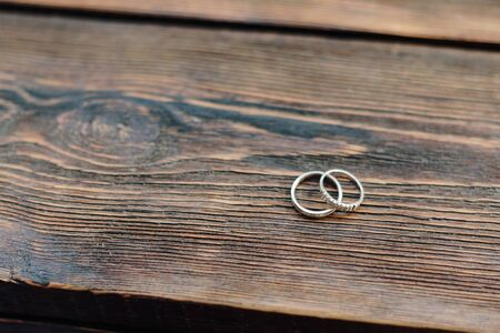 gold rings newlyweds on brown wooden background 1