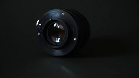 Old manual lens on a black background Archivio Fotografico