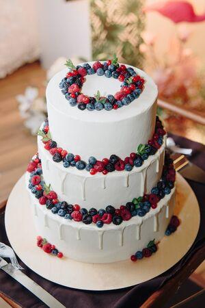 Big white cake with fresh berries