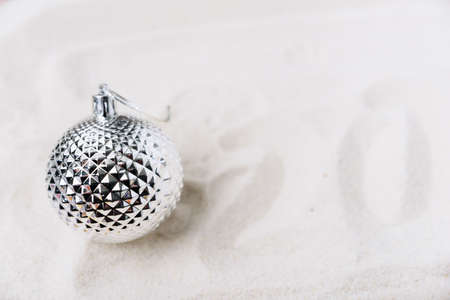 Christmas tree toys on white sand Stock Photo