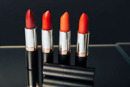 Lipstick in different colors on a dark background