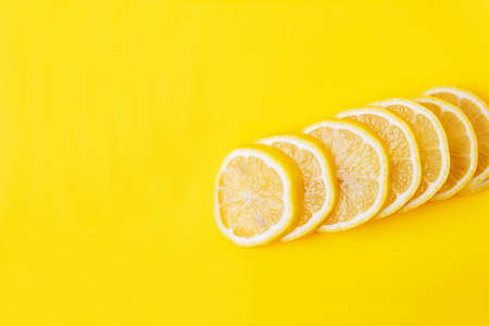 Lemon slices on a yellow Board close up