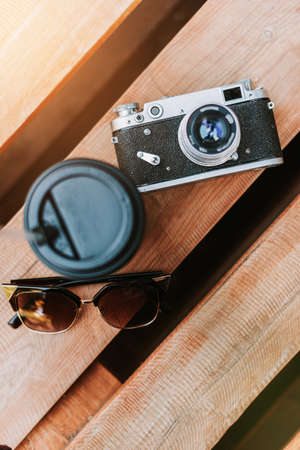 Vintage camera on a wooden surface close-up