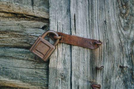 Old rusty lock on an old wooden door
