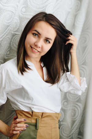 portrait of a beautiful brunette girl at home
