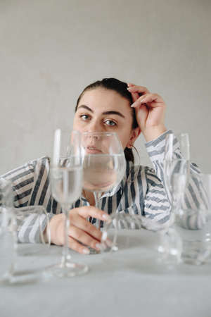 beautiful girl with glasses of water on the table