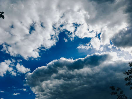 Blue sky with beautiful and fluffy white clouds