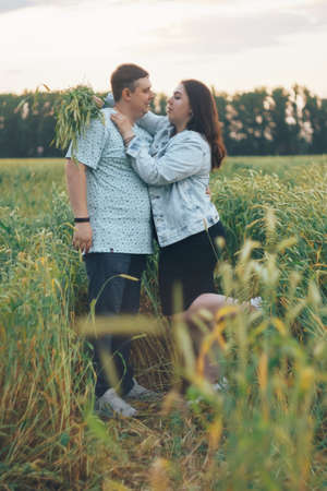 Young adult man and woman in a wheat field