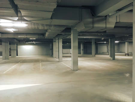 empty lighted underground parking lot