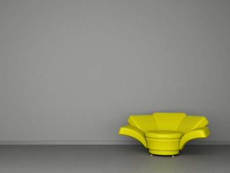 interior design of a yellow modern armchair on a grey wall Stock Photo