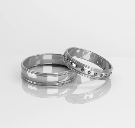 Wedding rings with brilliants on a white background Stock Photo - 12445990