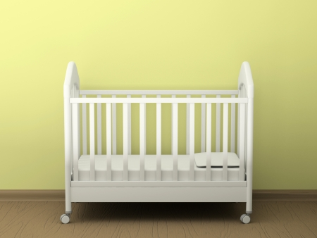 White cot in an empty room Stock Photo