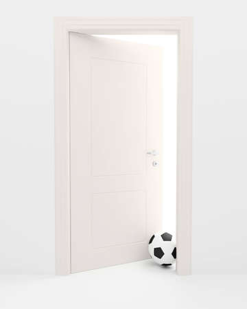 threshold: Football on a threshold of the white slightly opened door