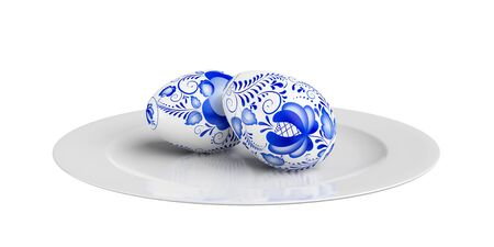 Two Easter eggs on a plate. Isolated on a white background photo