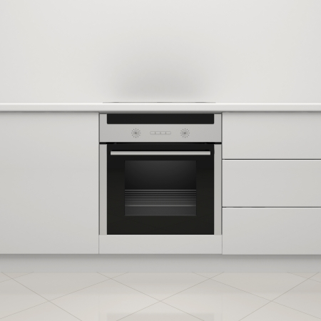 White kitchen with an electric stove and an oven Stock Photo