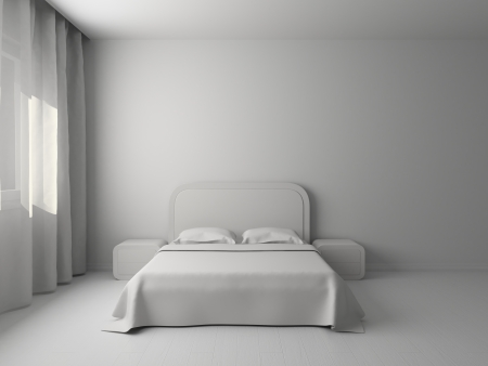 White interior of a bedroom with a big double bed